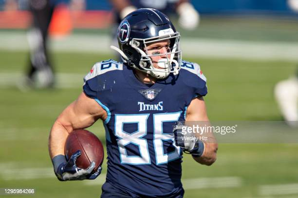 Tight end Anthony Firkser of the Tennessee Titans runs the ball during their AFC Wild Card Playoff game against the Baltimore Ravens at Nissan...