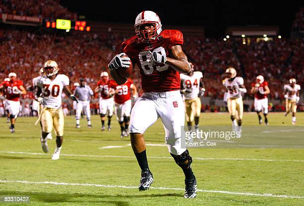 Tight end Anthony Hill of the North Carolina State Wolfpack runs in for a touchdown against the Florida State Seminoles during the game at...
