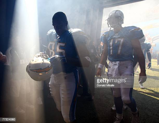 Tight End Antonio Gates and Philip Rivers of the San Diego Chargers walk through the tunnel prior to their game against the Oakland Raiders on...