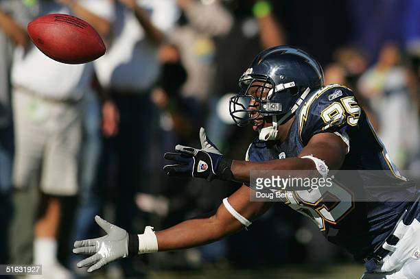 Tight end Antonio Gates of the San Diego Chargers can't quite hand on to a pass in the endzone against the Oakland Raiders at Qualcomm Stadium on...