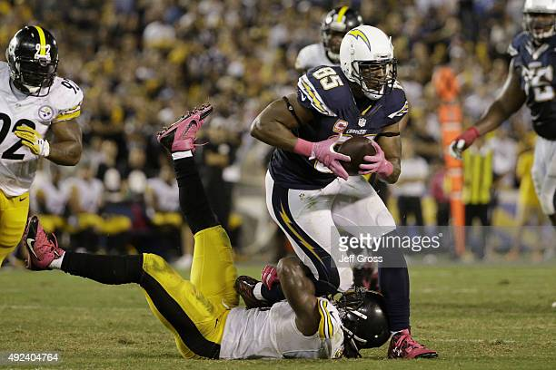 Tight end Antonio Gates of the San Diego Chargers is tackled by inside linebacker Sean Spence of the Pittsburgh Steelers at Qualcomm Stadium on...