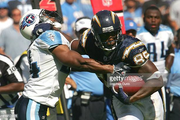 Tight end Antonio Gates of the San Diego Chargers runs with the ball against safety Chris Hope of the Tennessee Titans during the NFL game held on...