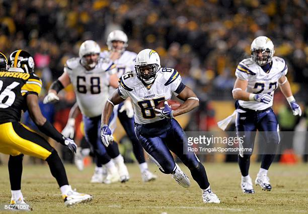 Tight end Antonio Gates of the San Diego Chargers runs with the ball against the Pittsburgh Steelers during their AFC Divisional Playoff Game on...