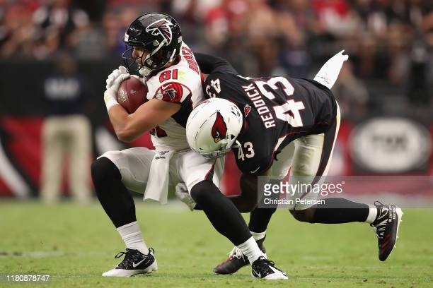 Tight end Austin Hooper of the Atlanta Falcons makes a reception against outside linebacker Haason Reddick of the Arizona Cardinals during the second...