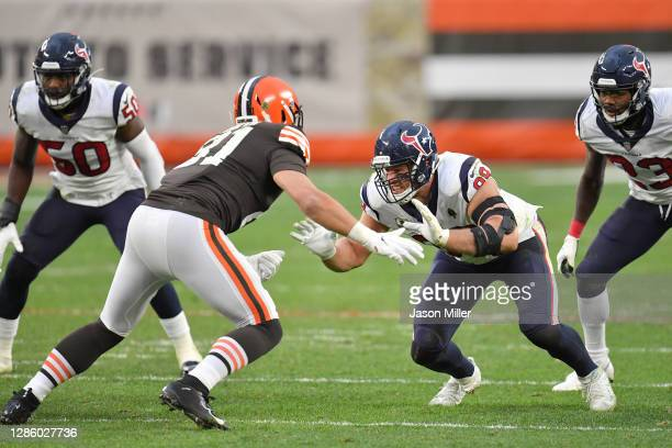 Tight end Austin Hooper of the Cleveland Browns battles with defensive end J.J. Watt of the Houston Texans during the second half at FirstEnergy...