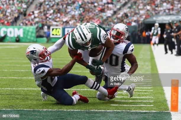 Tight end Austin SeferianJenkins of the New York Jets is seen fumbling the ball after what was originally called a touchdown against strong safety...