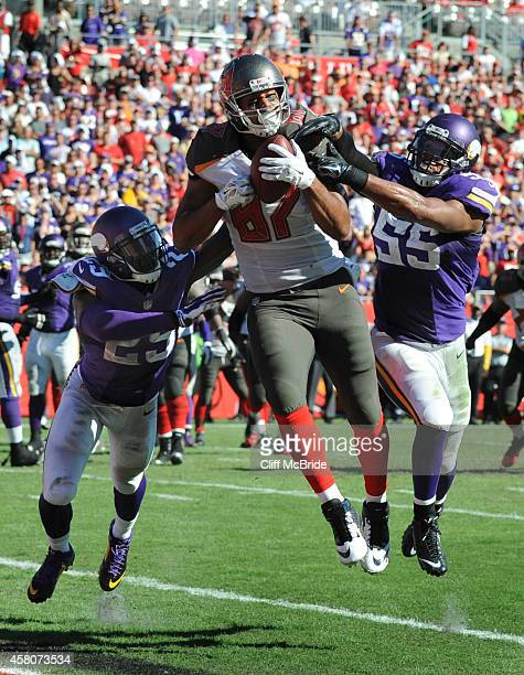 Tight end Austin SeferianJenkins of the Tampa Bay Buccaneers catches a touch down pass as cornerback Xavier Rhodes and outside linebacker Anthony...