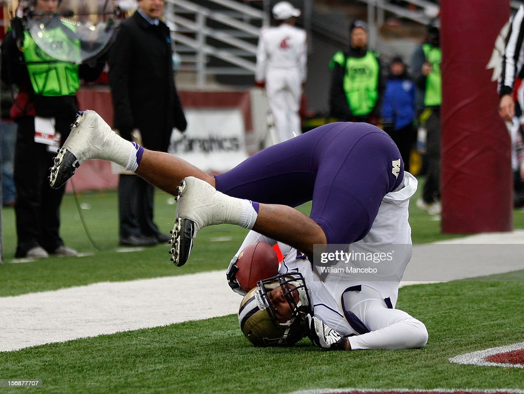 Tight end Austin-Seferian Jenkins #88 of the Washington Huskies reacts after scoring a touchdown that put the Huskies on the board early in the second quarter during the game against the Washington State Cougars at Martin Stadium on November 23, 2012 in Pullman, Washington.