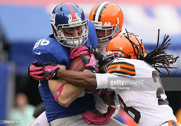 Tight end Bear Pascoe of the New York Giants is tackled by free safety Usama Young of the Cleveland Browns during their game at MetLife Stadium on...