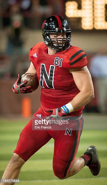 Tight end Ben Cotton of the Nebraska Cornhuskers runs with the ball through the Wisconsin Badgers during their game at Memorial Stadium on September...