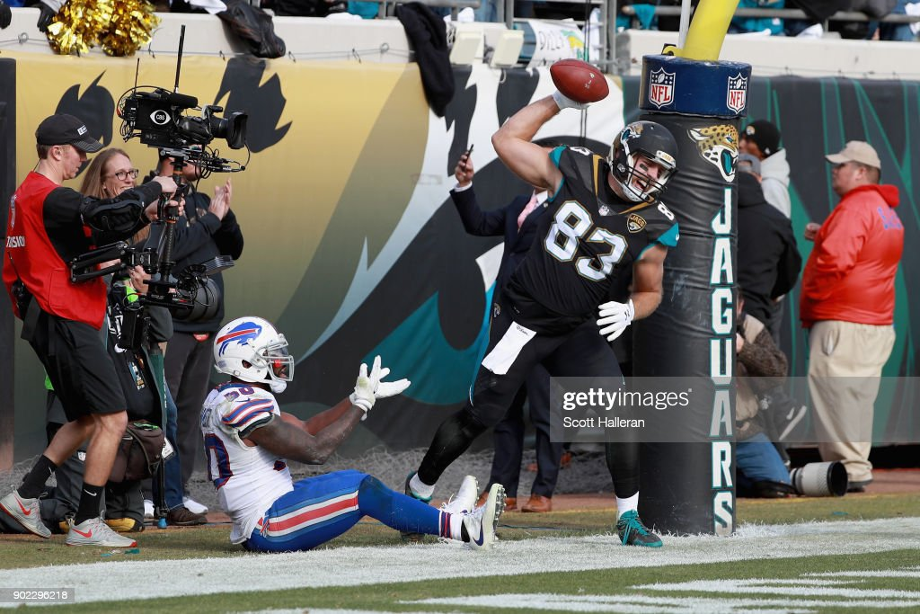 Tight end Ben Koyack #83 of the Jacksonville Jaguars spikes the ball in front of outside linebacker Ramon Humber #50 of the Buffalo Bills after catching a third quarter touchdown pass during the AFC Wild Card Playoff game at EverBank Field on January 7, 2018 in Jacksonville, Florida.