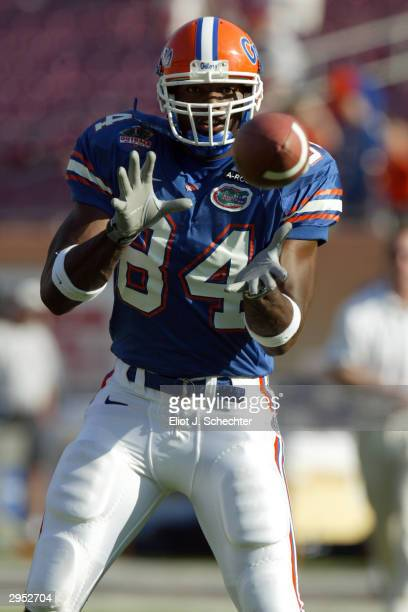 Tight end Ben Troupe of the Florida Gators sets up for the catch during the game against the Iowa Hawkeyes in the Outback Bowl on January 1, 2004 at...