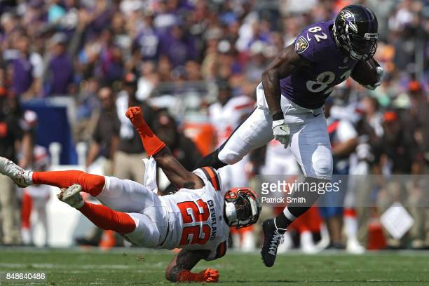 Tight end Benjamin Watson of the Baltimore Ravens eludes free safety Jabrill Peppers of the Cleveland Browns as he rushes up the field during the...