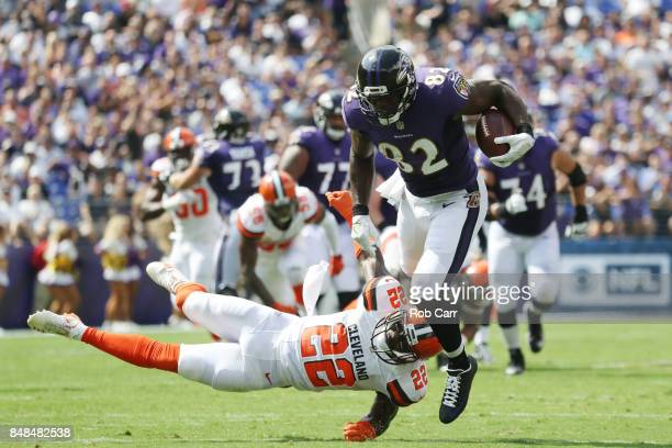 Tight end Benjamin Watson of the Baltimore Ravens gets tackled by free safety Jabrill Peppers of the Cleveland Browns in the second quarter at MT...