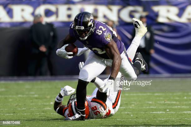 Tight end Benjamin Watson of the Baltimore Ravens is tackled by inside linebacker James Burgess of the Cleveland Browns at MT Bank Stadium on...