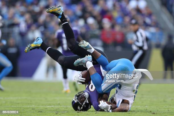 Tight End Benjamin Watson of the Baltimore Ravens is tackled in the third quarter against the Detroit Lions at MT Bank Stadium on December 3 2017 in...