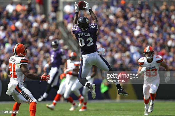 Tight end Benjamin Watson of the Baltimore Ravens makes a catch in front of cornerback Jamar Taylor of the Cleveland Browns during the first half at...