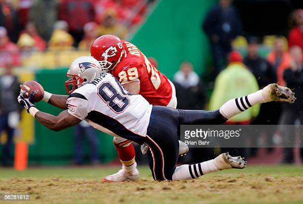 Tight end Benjamin Watson of the New England Patriots can't hold onto a pass as he is hit by safety Sammy Knight of the Kansas City Chiefs in the...