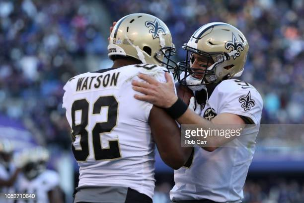 Tight End Benjamin Watson of the New Orleans Saints and quarterback Drew Brees celebrate after a touchdown in the second quarter against the...