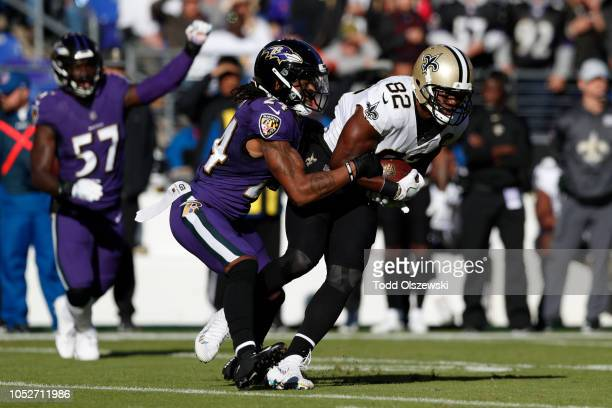 Tight end Benjamin Watson of the New Orleans Saints is tackled by cornerback Brandon Carr of the Baltimore Ravens in the first quarter at MT Bank...