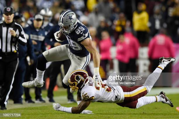 Tight end Blake Jarwin of the Dallas Cowboys is tackled by strong safety Montae Nicholson of the Washington Redskins in the fourth quarter at...