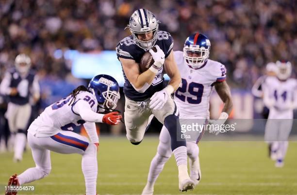 Tight end Blake Jarwin of the Dallas Cowboys runs in for a touchdown in the second quarter over the defense of the New York Giants at MetLife Stadium...