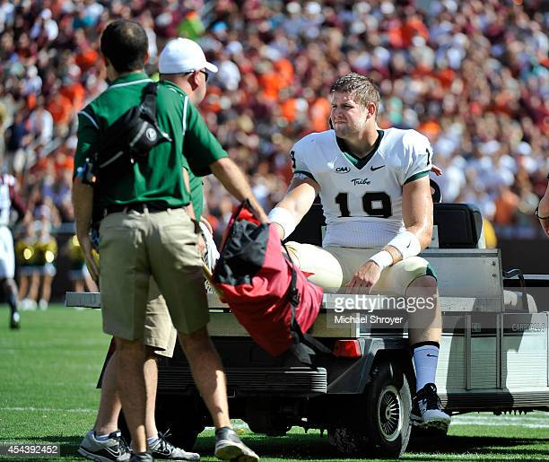 Tight end Bo Revell of the William Mary Tribe is carted off after being injured against Virginia Tech Hokies in the first half at Lane Stadium on...