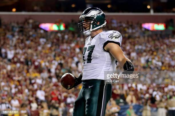 Tight end Brent Celek of the Philadelphia Eagles celebrates he catches a 28yard touchdown in the second quarter against the Washington Redskins at...