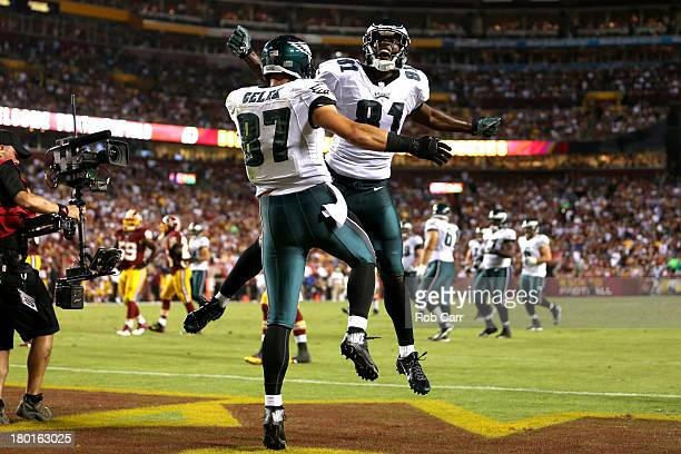 Tight end Brent Celek of the Philadelphia Eagles celebrates with wide receiver Jason Avant after Celek catches a 28yard touchdown in the second...