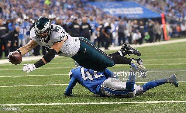 Tight end Brent Celek of the Philadelphia Eagles dives over strong safety Isa AbdulQuddus of the Detroit Lions for a second quarter touchdown on...