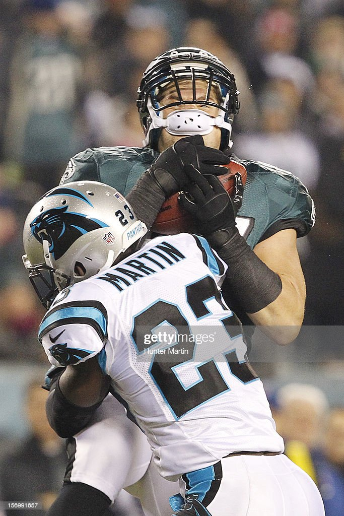 Tight end Brent Celek #87 of the Philadelphia Eagles gets hit by free safety Sherrod Martin #23 of the Carolina Panthers after catching a pass during a game on November 26, 2012 at Lincoln Financial Field in Philadelphia, Pennsylvania. The Panthers won 30-22.