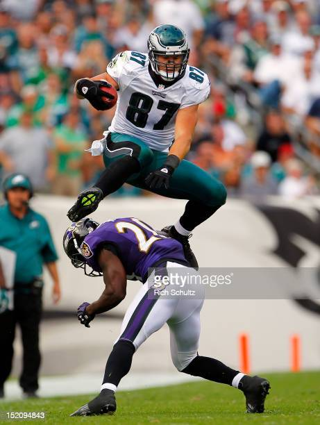 Tight end Brent Celek of the Philadelphia Eagles leaps over safety Ed Reed for a first down in the third quarter during a game at Lincoln Financial...