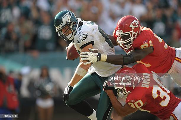 Tight end Brent Celek of the Philadelphia Eagles scores a touchdown while getting tackled by safety Mike Brown of the Kansas City Chiefs on September...