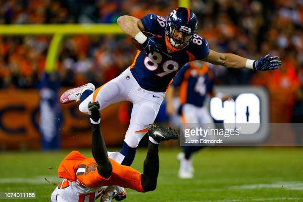 Tight end Brian Parker of the Denver Broncos dives forward after a catch against the Cleveland Browns in the first quarter of a game at Broncos...