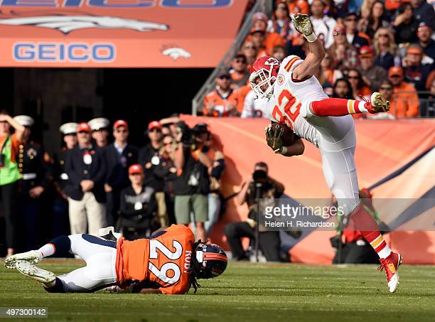 Tight end Brian Parker of the Kansas City Chiefs gains 7 yards as he is taken down by free safety Bradley Roby of the Denver Broncos in the first...