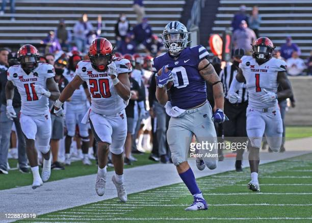 Tight end Briley Moore of the Kansas State Wildcats rushes down field after catching a pass for 66 yard against the Texas Tech Red Raiders, during...