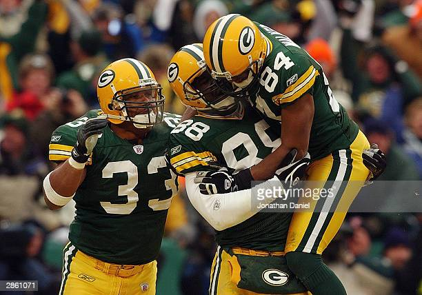 Tight end Bubba Franks of the Green Bay Packers is jumped on by teammate Javon Walker after Franks scored a touchdown against the Seattle Seahawks in...