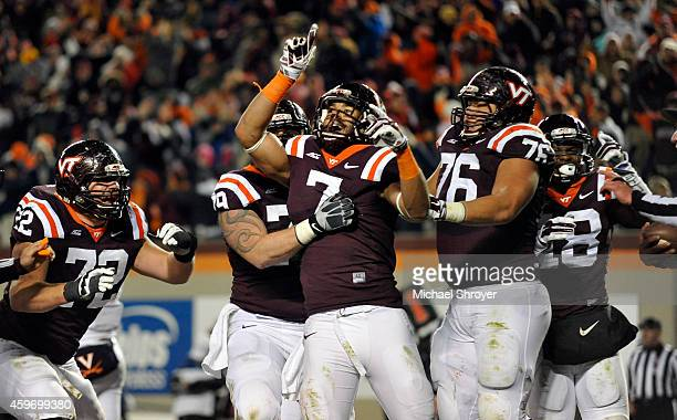 Tight end Bucky Hodges celebrates his eventual game winning touchdown with offensive lineman David Wang of the Virginia Tech Hokies in the second...