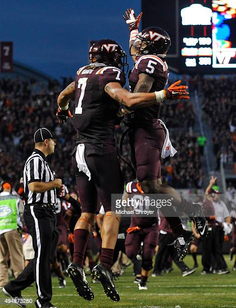 Tight end Bucky Hodges of the Virginia Tech Hokies celebrates his touchdown reception with wide receiver Cam Phillips in the fourth quarter against...