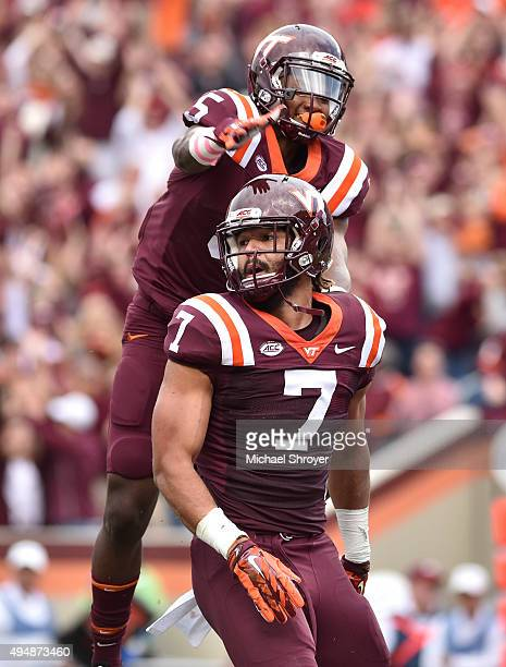 Tight end Bucky Hodges of the Virginia Tech Hokies celebrates his touchdown reception with wide receiver Cam Phillips in the first half against the...
