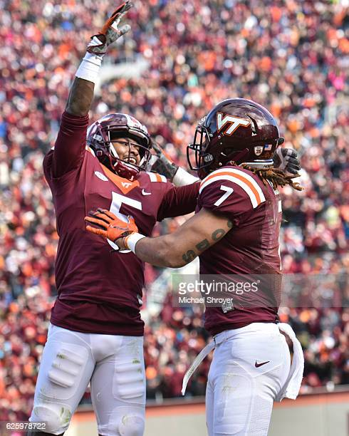 Tight end Bucky Hodges of the Virginia Tech Hokies celebrates his touchdown reception against the Virginia Cavaliers with wide receiver Cam Phillips...