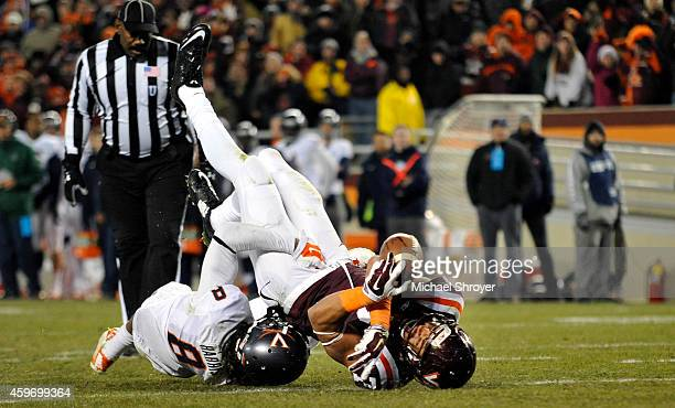 Tight end Bucky Hodges of the Virginia Tech Hokies dives across the goal line to score the game winning touchdown while being tackled by strong...