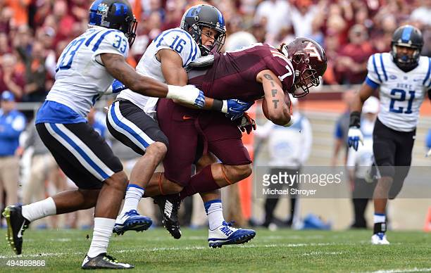 Tight end Bucky Hodges of the Virginia Tech Hokies is hit by safety Jeremy Cash of the Duke Blue Devils during a touchdown reception in the first...