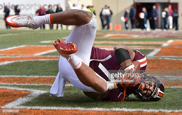 Tight end Bucky Hodges of the Virginia Tech Hokies makes a touchdown reception against the Virginia Cavaliers at Lane Stadium on November 26 2016 in...