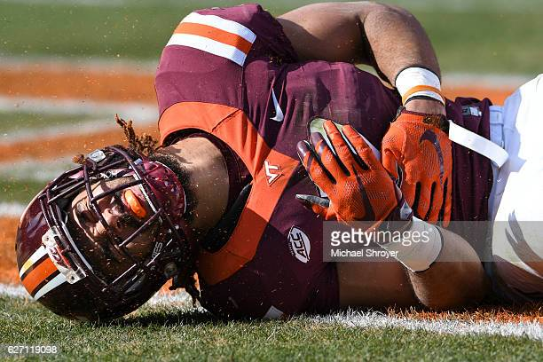 Tight end Bucky Hodges of the Virginia Tech Hokies reacts following an incomplete pass against the Virginia Cavaliers in the first half at Lane...