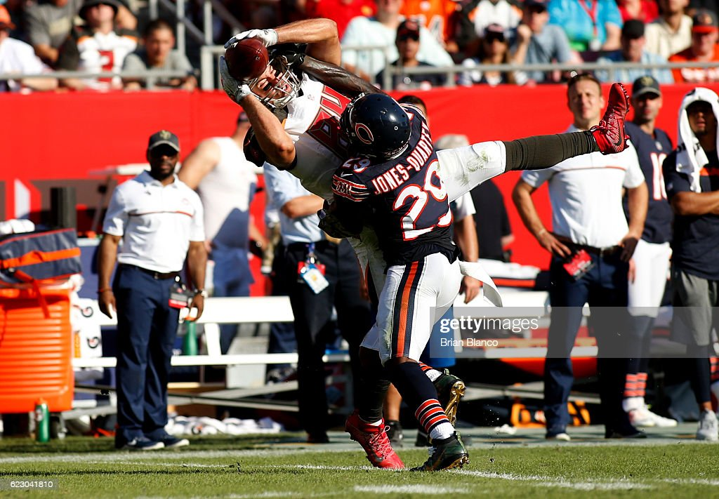 Tight end Cameron Brate #84 of the Tampa Bay Buccaneers hauls in a pass from quarterback Jameis Winston in front of strong safety Harold Jones-Quartey #29 of the Chicago Bears during the third quarter of an NFL game on November 13, 2016 at Raymond James Stadium in Tampa, Florida.