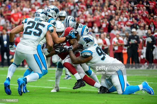 Tight end Charles Clay of the Arizona Cardinals carries the ball against the Carolina Panthers defenders in the NFL game at State Farm Stadium on...