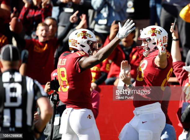 Tight end Charlie Kolar of the Iowa State Cyclones celebrates with teammate wide receiver Hakeem Butler of the Iowa State Cyclones after scoring a...