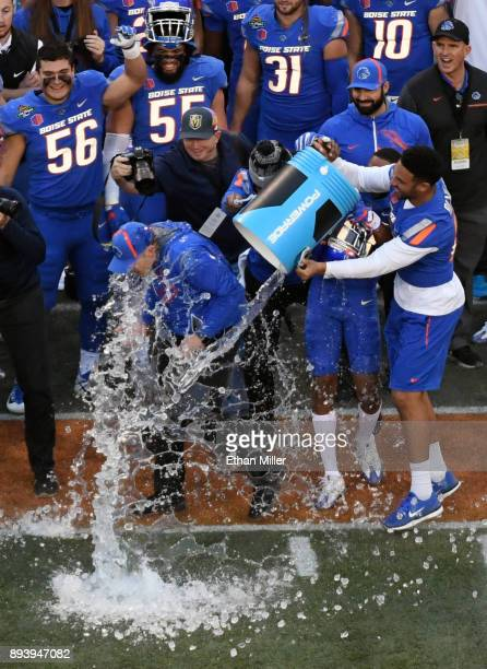 Tight end Chase Blakley of the Boise State Broncos helps dumps ice and water on head coach Bryan Harsin as time expires in their 3828 victory over...