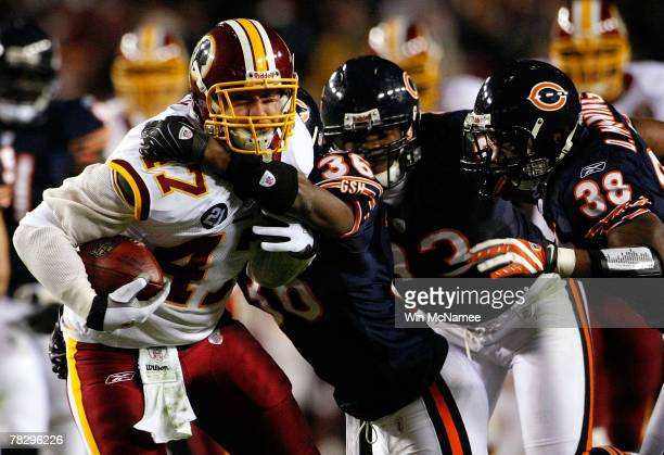Tight end Chris Cooley of the Washington Redskins is tackled after a reception by Chicago Bears safety Brandon McGowan and safety Danieal Manning in...